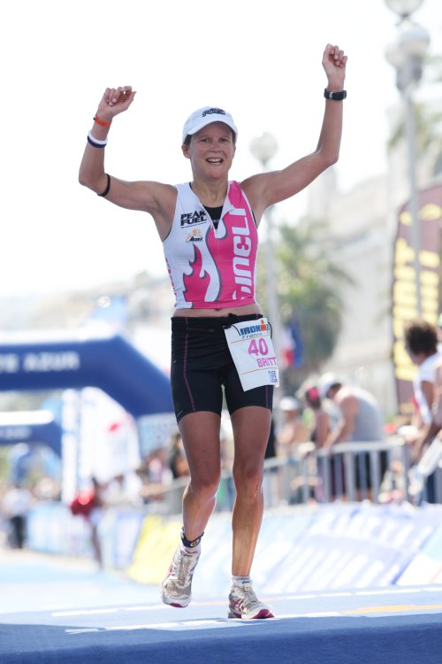 Britta Martin of Nelson crosses the finish line in fourth place at Ironman France in Nice, Sunday July 27, 2010